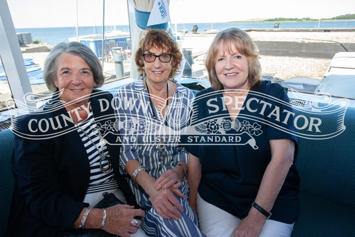 From left, Renee Watson, Evie Donaldson and Dorothy Wyness who enjoyed the commodore's reception on Saturday. P30-27-06-19